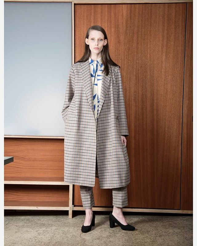 Our checkred trench in stores now. Photo by @jacobbuchard #veronicabvallenes