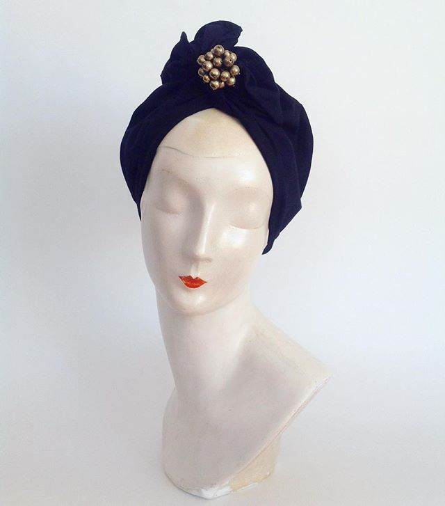 The 'Carrie' extra long twist top is a classic black cotton with vintage 1960s gold bauble detail that easily detaches for versatility. #netushkaturbans #netushka #vintageglamour #headwrap #vintageclothing #turbanstyle #headwrap #decostyle #gypsy #headaccessory #headwear #fashion