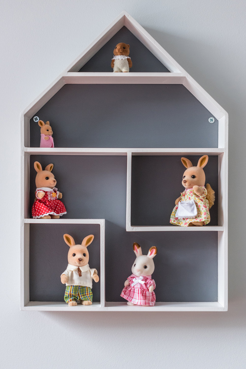 This wall house was an inexpensive find from Sainsburys. It is fixed to the wall close to the childs bed, providing her with lots of imaginary playtime and freeing up floor space.