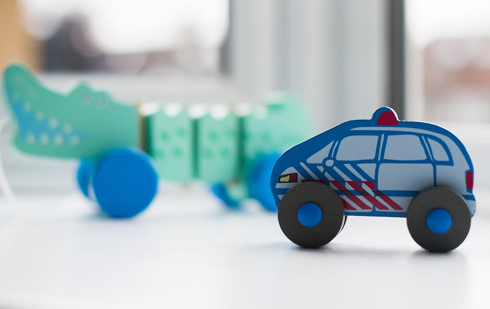Close up view of wooden toys in peacock coloured unisex nursery
