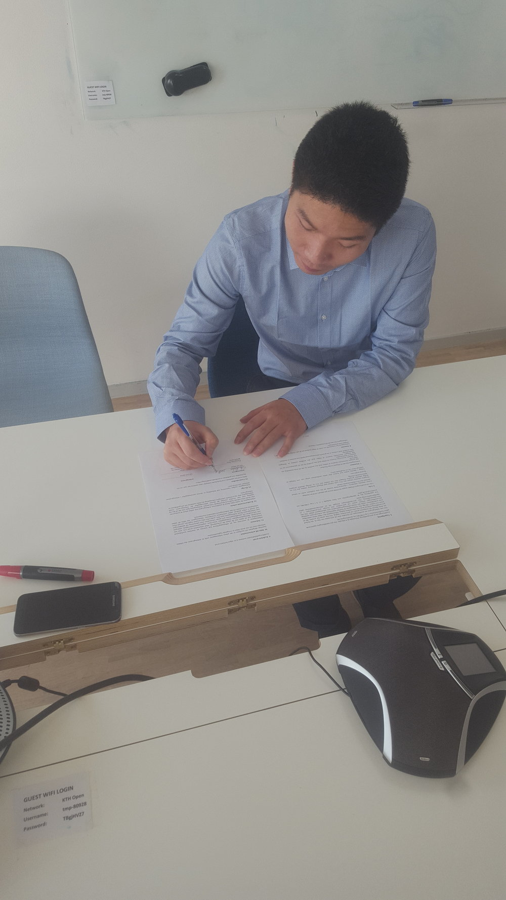 Chun signing his employment contract!