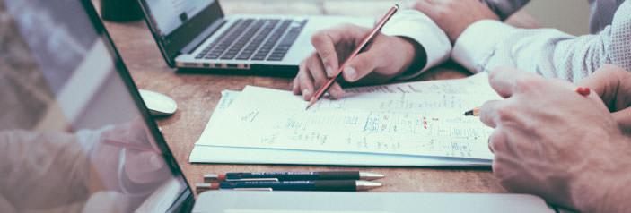 two-men-writing-on-desk.jpg