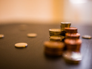 coins-stacked-on-a-desk-funding-hub.jpg