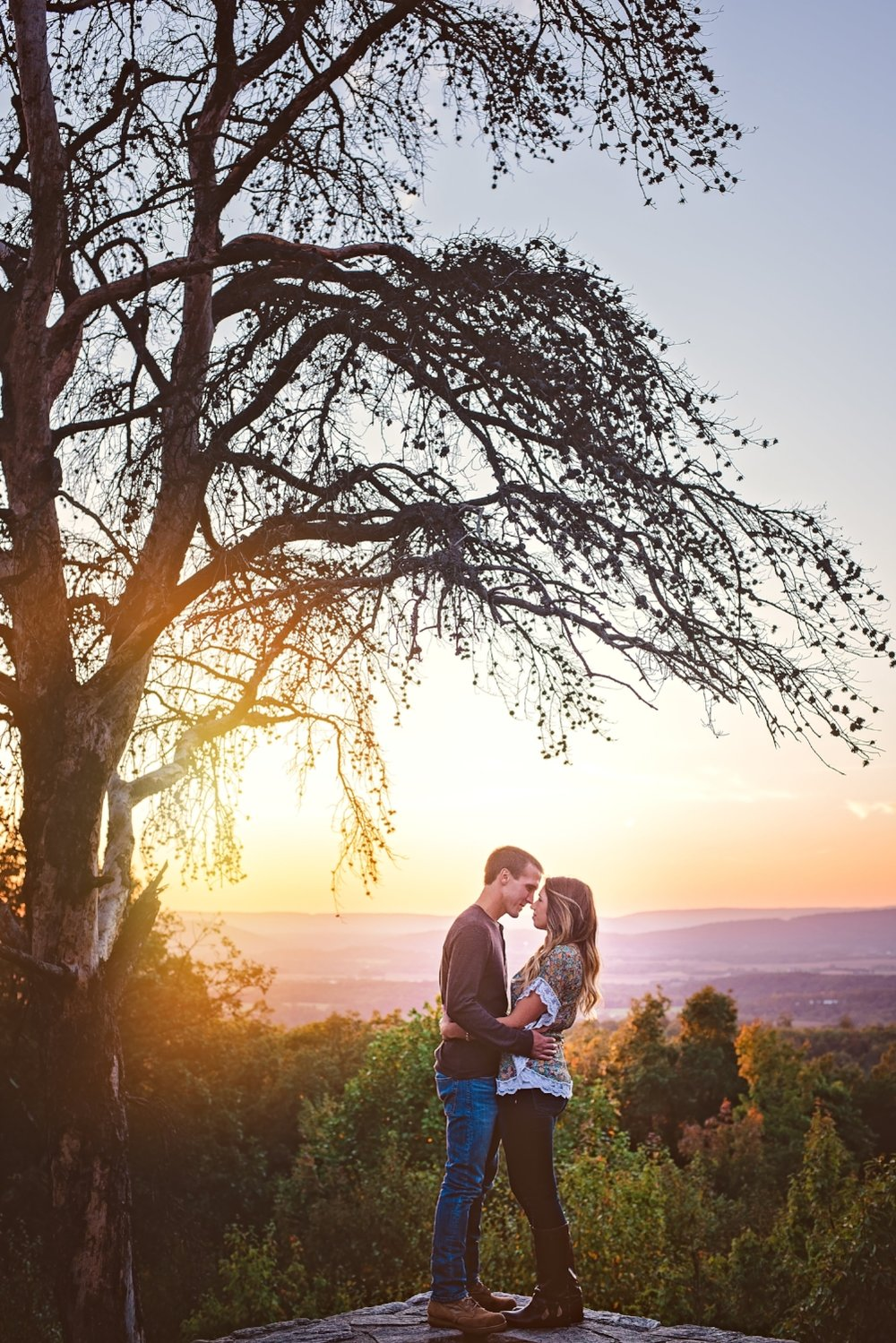sunset mountaintop engagement photography by 1001 angles photography