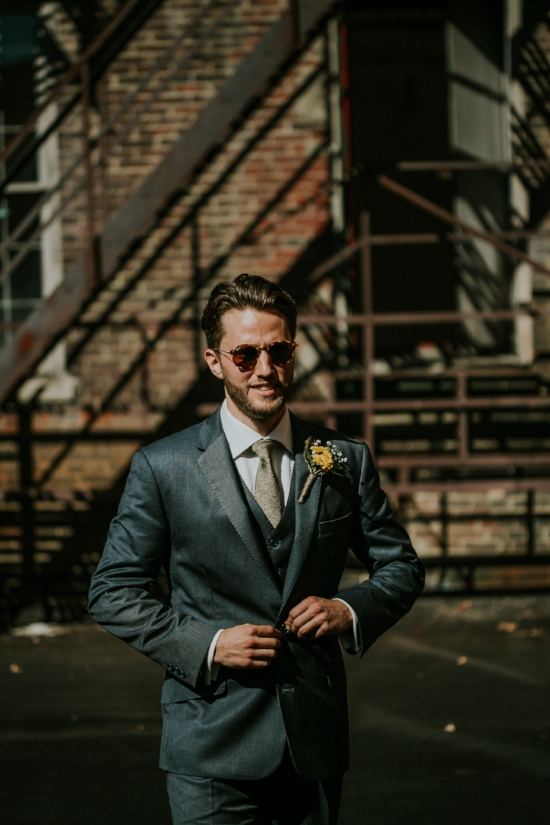 gorgeous groom in his ray bans