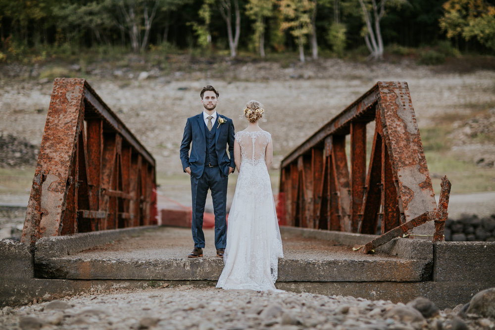 bride and groom on a bridge in connecticut