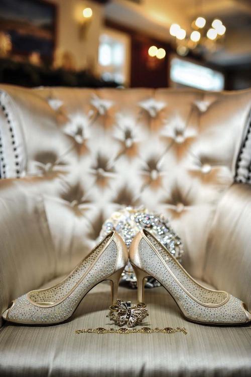 Brides shoes and bouquet