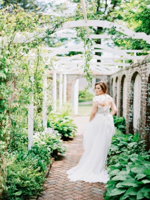 Bride walking through Keeler Tavern Garden