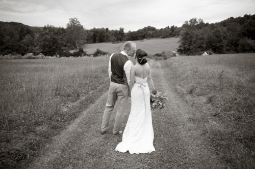 First look kiss in the fields - wedding planner