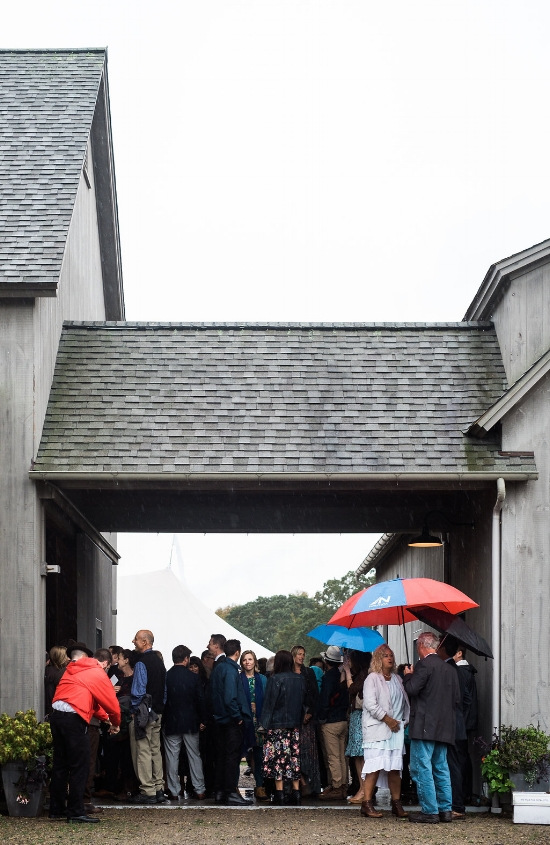 Guest huddled by the barn - Pearl Weddings & Events