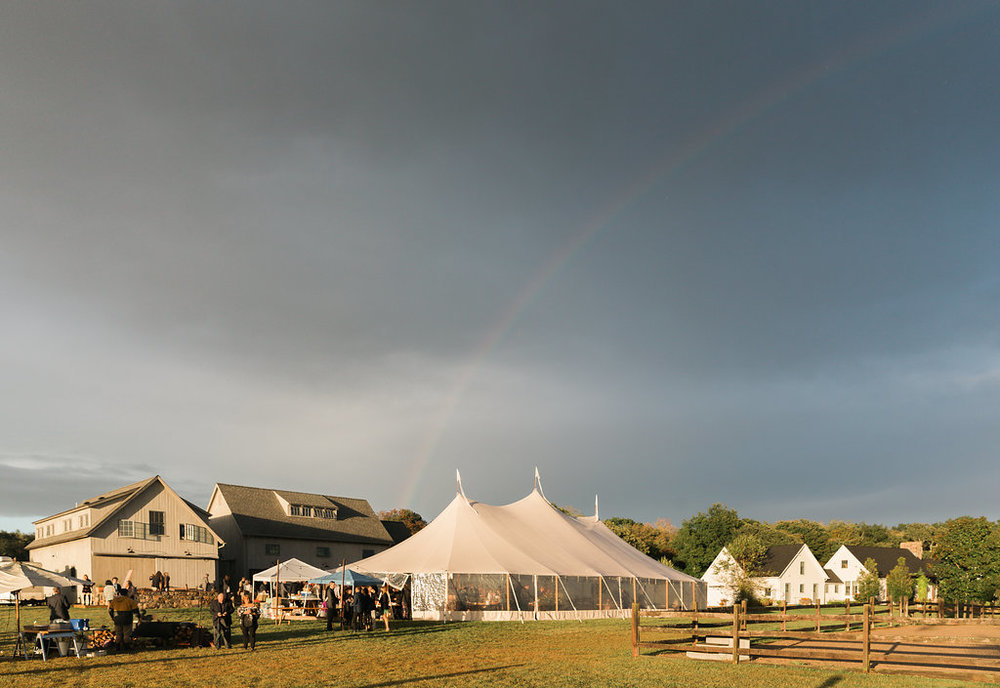 Outdoor tented wedding on a farm! This is inspiration for future brides looking to plan a beautiful outdoor wedding. Check out the beautiful rainbow too! Planner: Pearl Weddings & Events