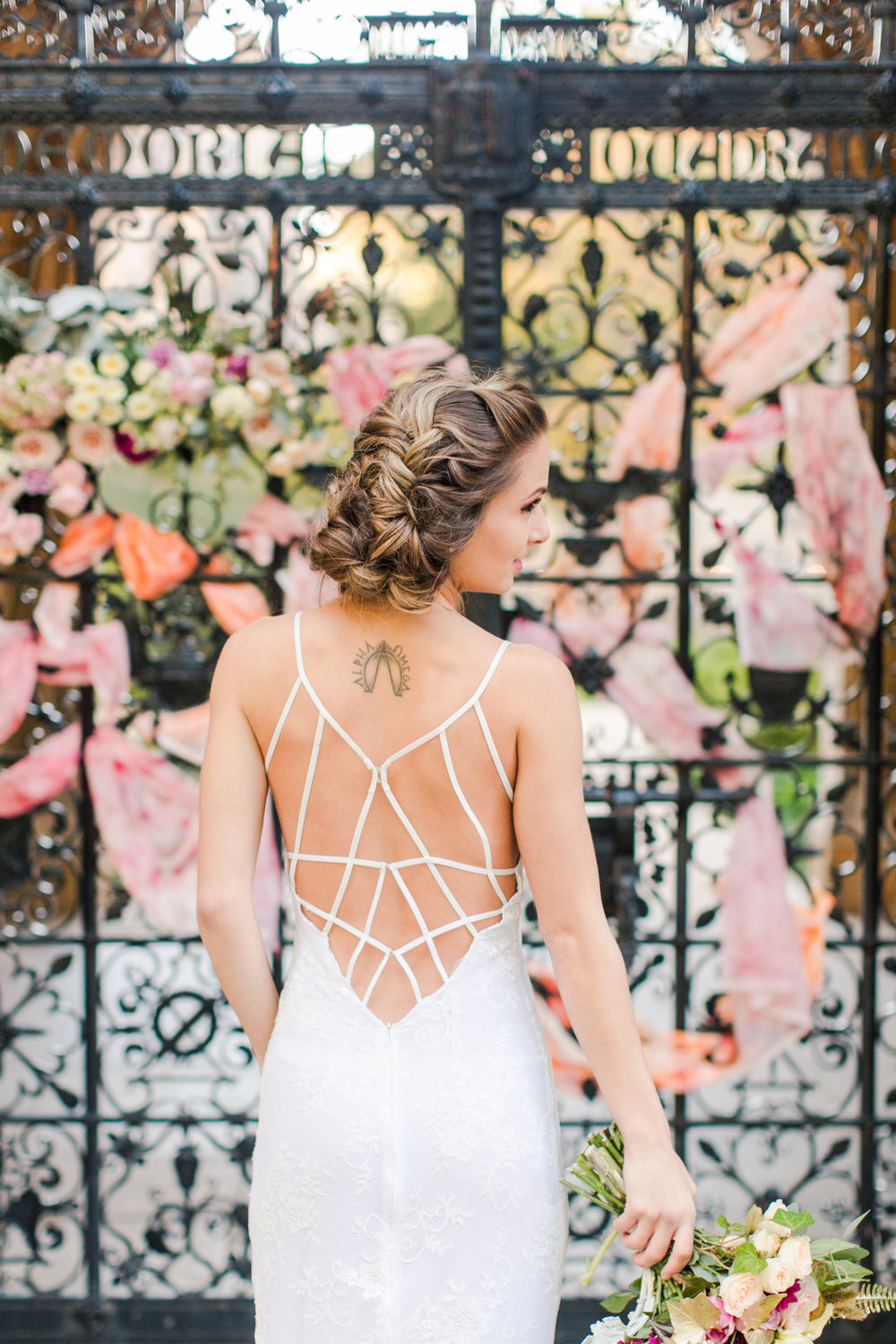 Brides intricate back strap dress with delicate lace - Pearl Weddings & Events