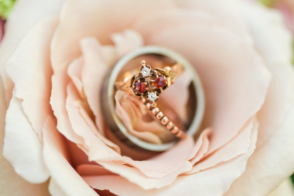 Antique gold and rose gold wedding/engagement rings in a pink flower! Pearl Weddings & Event