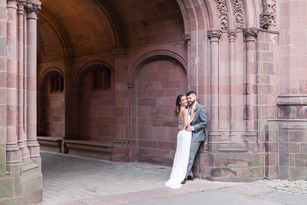 Bride and groom portraits on their wedding day. Lace open back bridal gown and grey groom's suit. Pearl Weddings & Events