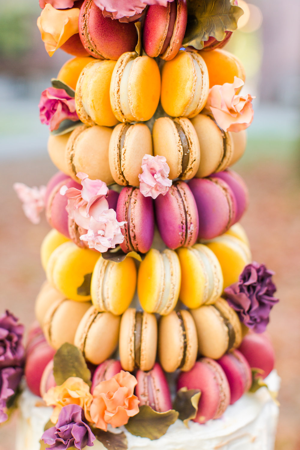 Macaroon tower wedding cake. Color scheme: pink, orange, purple and yellow. Pearl Weddings & Events