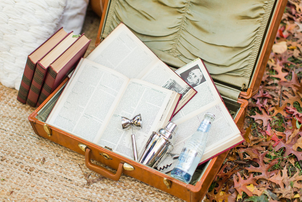 Vintage wedding details and vintage suitcase with bar set up. Pearl Weddings & Events