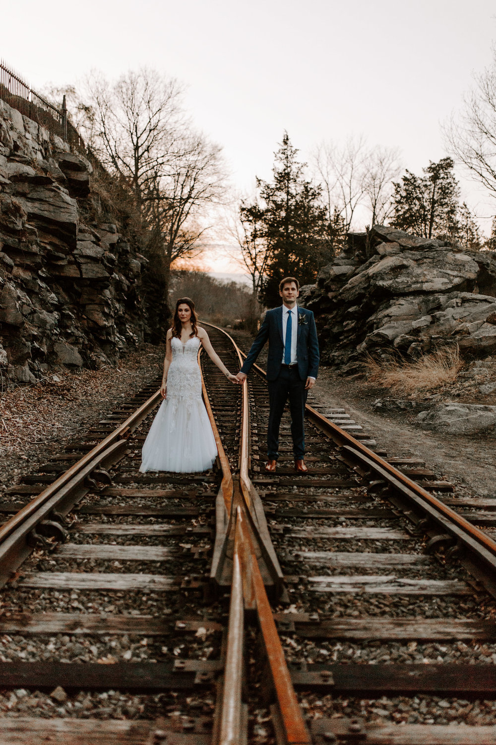 bride and groom on the train tracks looking fly. - Pearl Weddings & Events