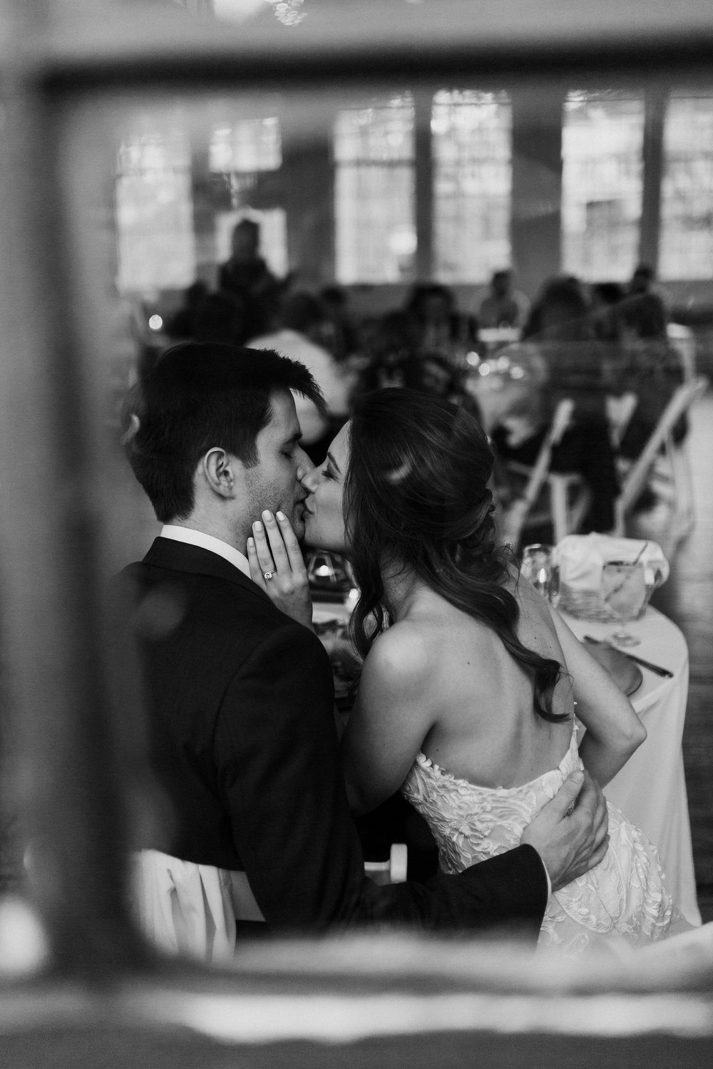 Catching those kisses from the bride and groom. - Pearl Weddings & Events