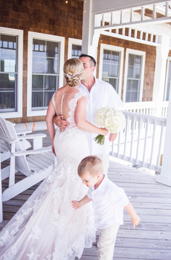 First look at the beach with the entire family! Katie & Mark's destination wedding in the Outer Banks of Corolla North Carolina. Planned & Designed with Pearl Weddings & Events.