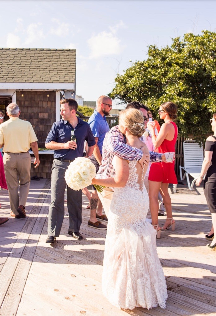 Katie & Mark's destination wedding in the Outer Banks of Corolla North Carolina. Planned & Designed with Pearl Weddings & Events.