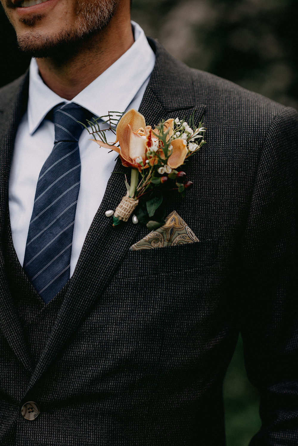 Groom boutonniere with a tweed detailed suit - Pearl Weddings & Events