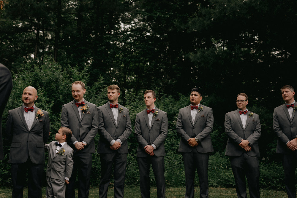 Groomsmen in grey suits with red bow ties - Pearl Weddings & Events