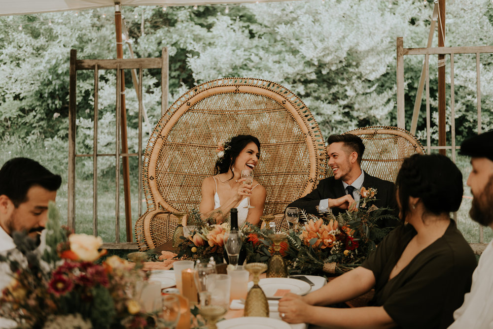 Boho wedding with bride and groom chairs - Pearl Weddings & Events