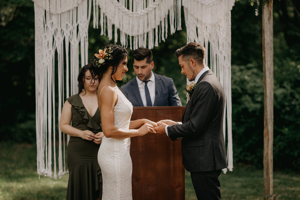 Macrame ceremony back drop with podium. Ring exchange between husband and wife. - Pearl Weddings & Events