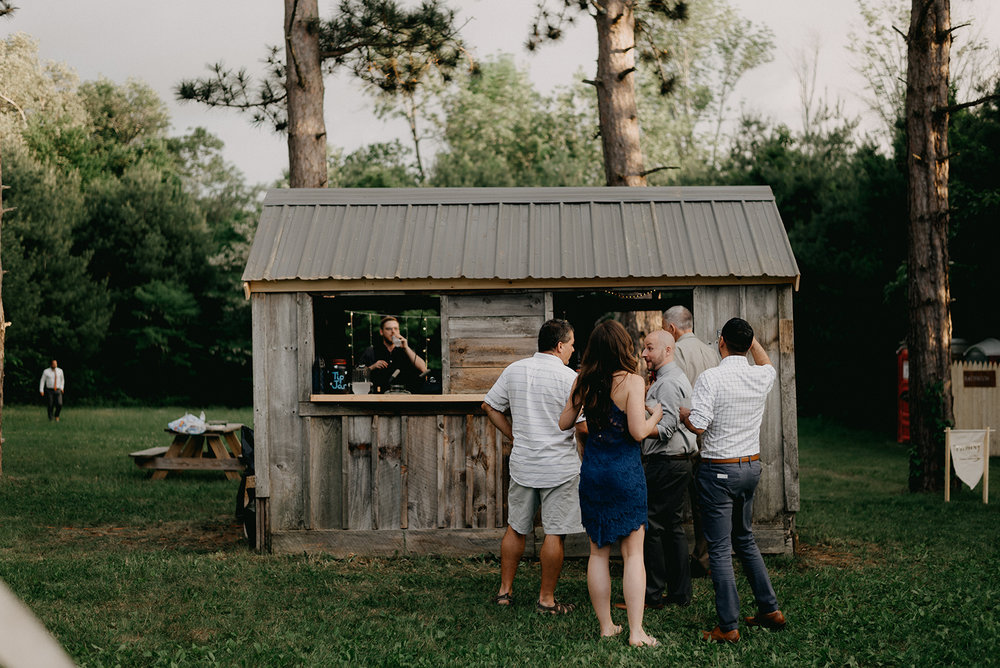 Bar set up at an outdoor tented wedding in Massachusetts - Pearl Weddings & Events