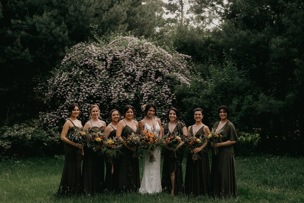 The bridal party in forest green dress of all different designs - Pearl Weddings & Events
