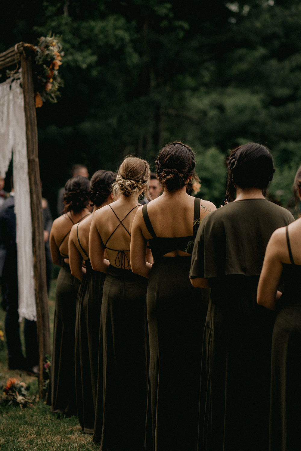 Forest greens dresses of bridesmaids from the back - Pearl Weddings & Events