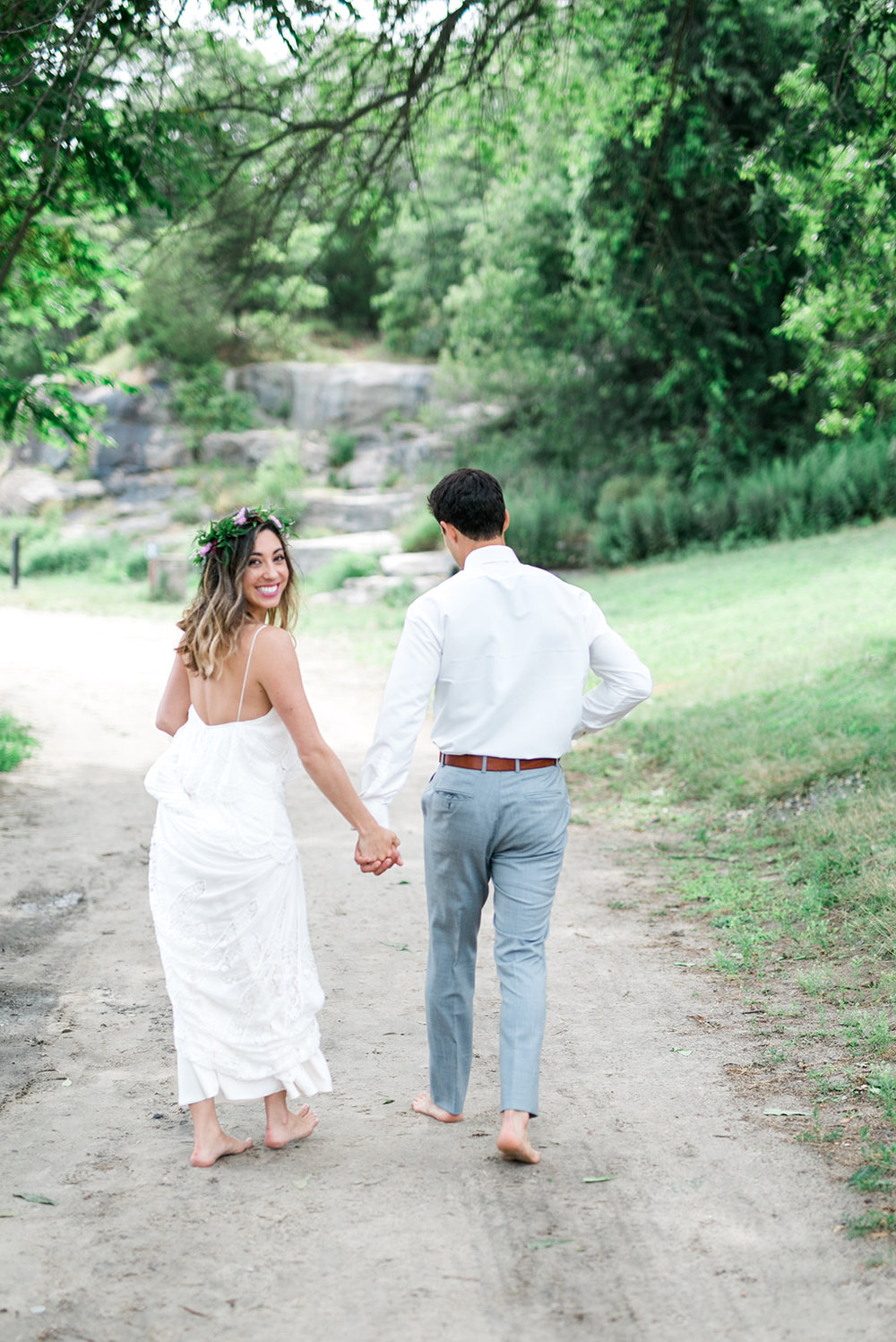 Bride and Groom walking Rocky Neck State Park in Connecticut - Pearl Weddings & Events