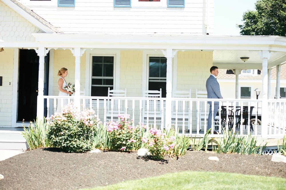 First look on the porch at the Admiral Dewey Inn in Rhode Island - Pearl Weddings & Events