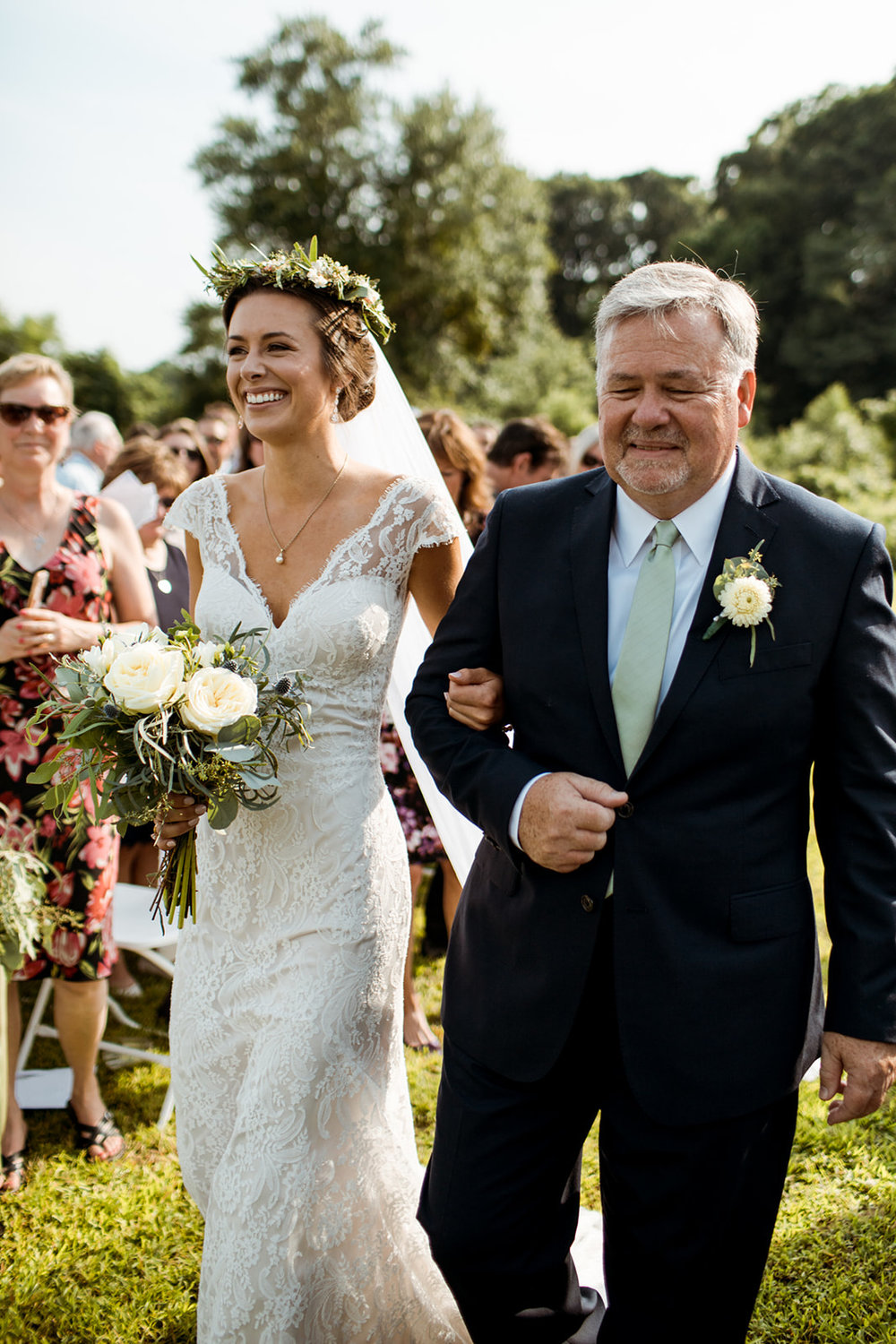 Bride and her father walking down the aisle in Chester, Connecticut with a floral crown - Pearl Weddings & Events