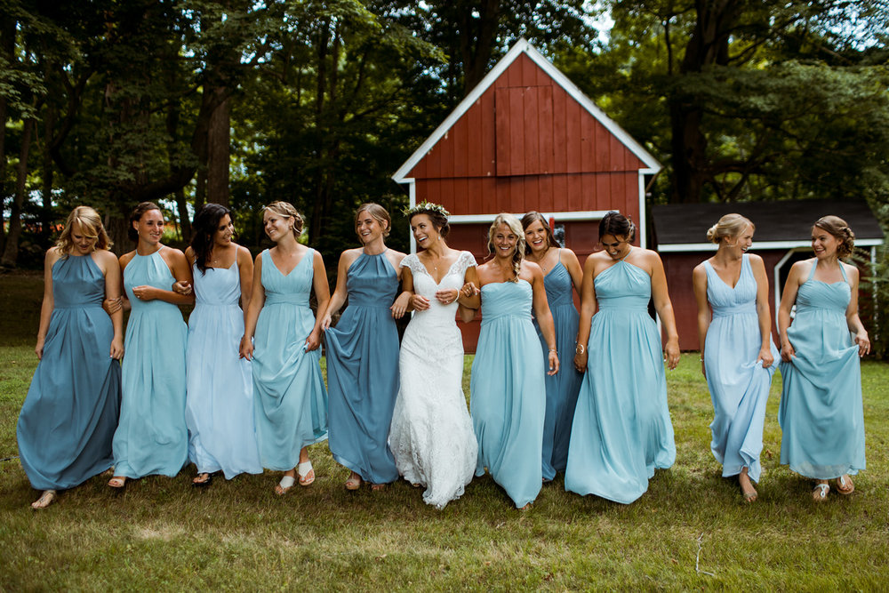 A beautiful bride and her tribe in blue bridesmaids dresses - Pearl Weddings & Events