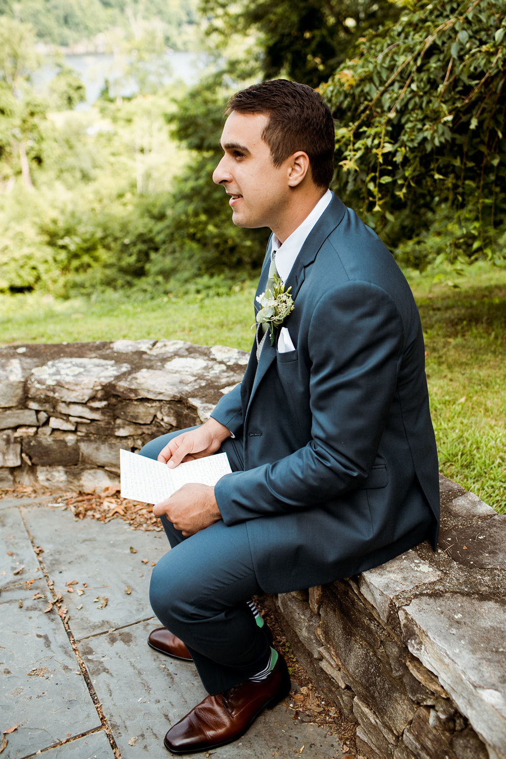 Groom reading his note from his bride - Pearl Weddings & Events