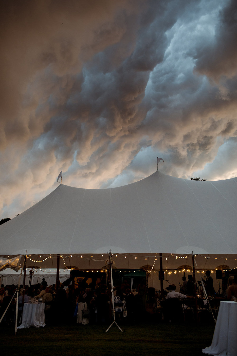 Rain clouds over the tent at a wedding reception - Pearl Weddings & Events