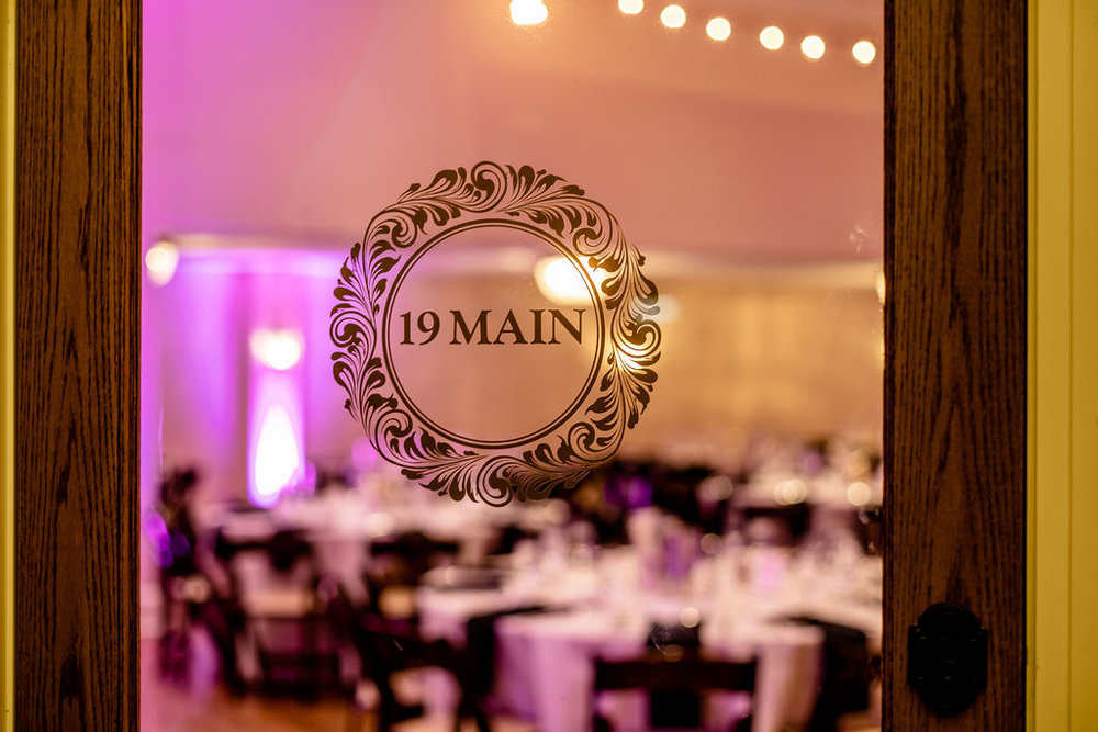 19 Main New Years Eve wedding photos into the reception space through the doors - Pearl Weddings & Events