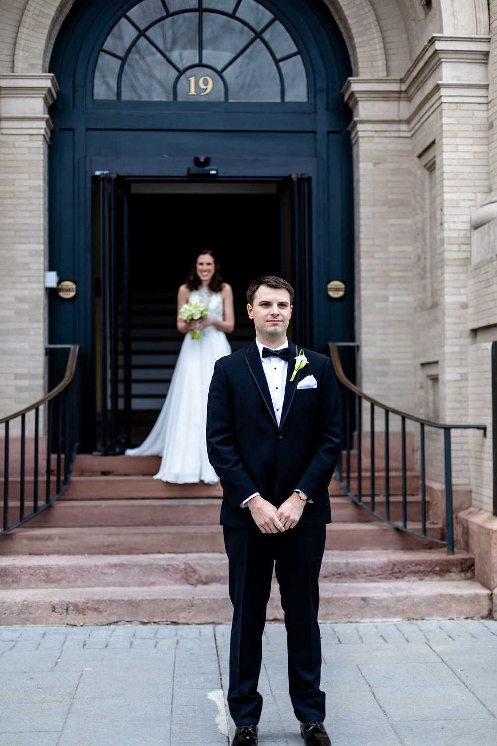 First look in front of the building at the entrance of 19 Main - Pearl Weddings & Events