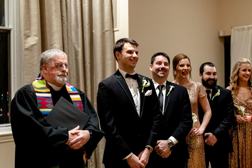 Groom with the bridal party at the altar. Bridesmaid and groomsmen on the same side as the groom. Mixing up the bridal party stance at the altar - Pearl Weddings & Events