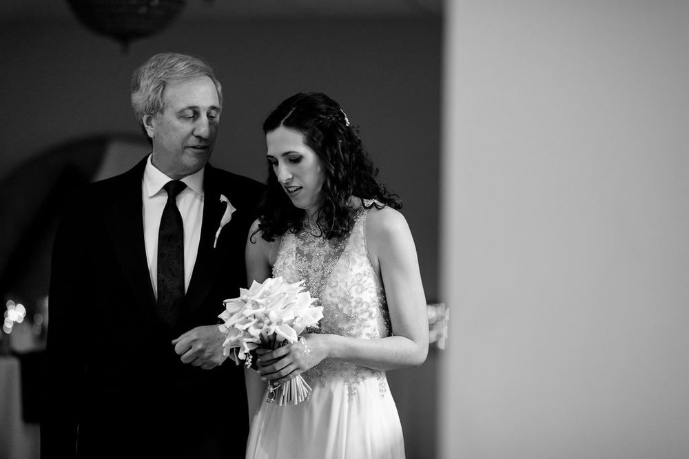bride and father right before they walk down the aisle - Pearl Weddings & Events
