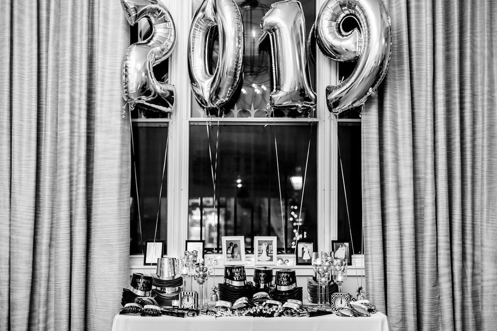 NYE table of goodies, hats, noise makers and fun for the New Years Eve Wedding - Pearl Weddings & Events