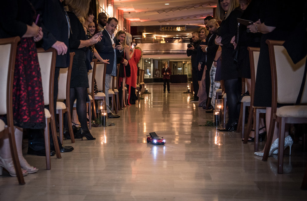 ring bearer driving the rings down the aisle in an electric car! - Pearl Weddings & Events