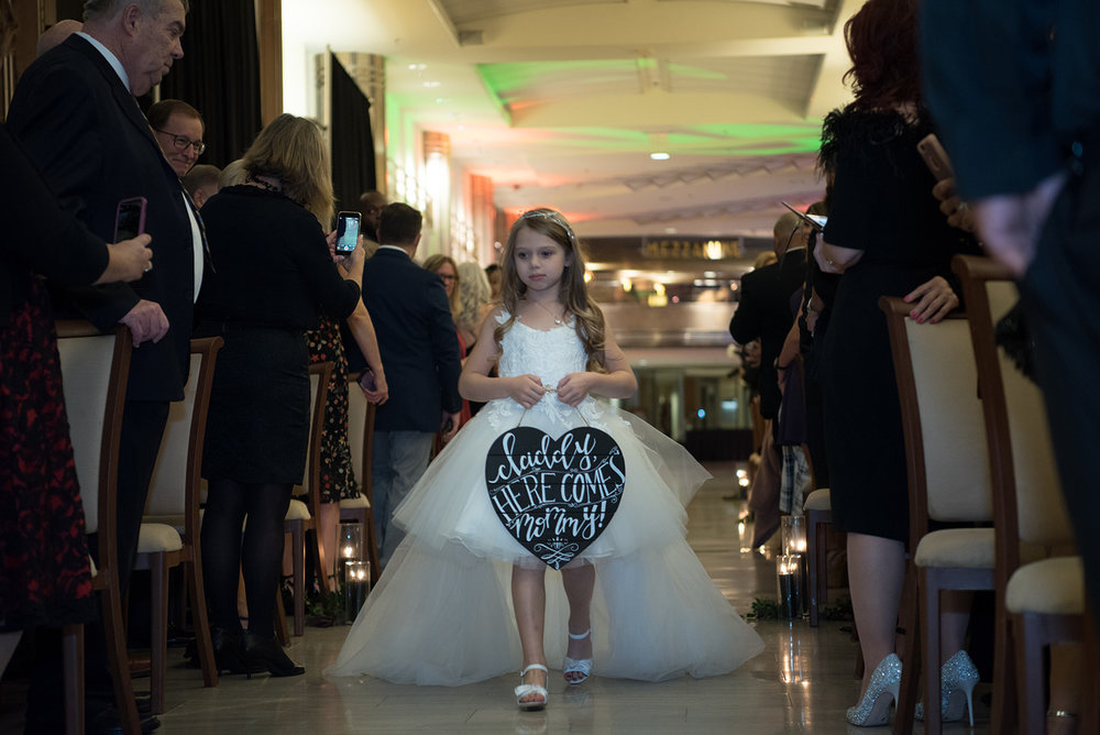 "flower girl carrying a sign that says ""daddy here comes mommy"" - Pearl Weddings  & Events"