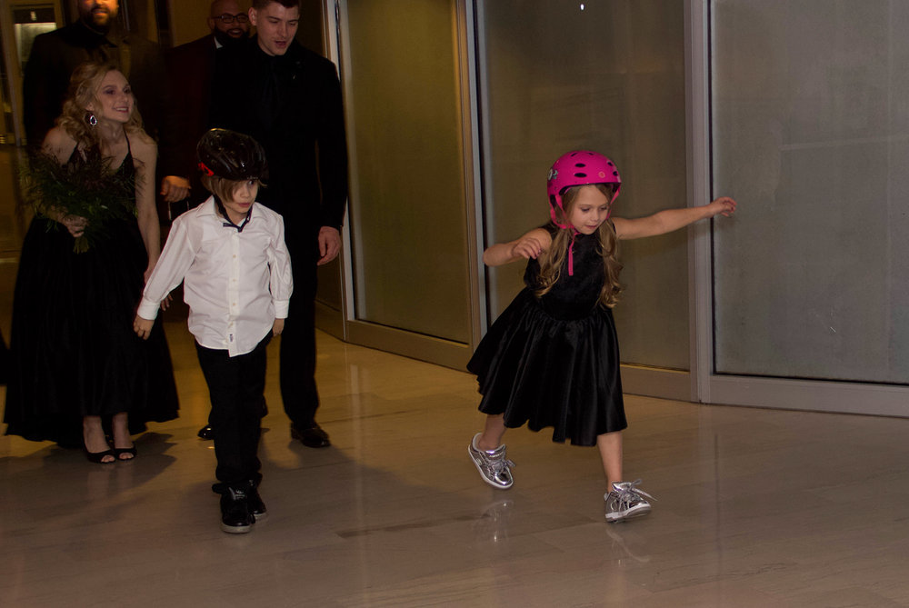 "ring bearer and flower girl entering in on their heelys to the song ""rollin"" Chamillionaire - Pearl Weddings & Events"