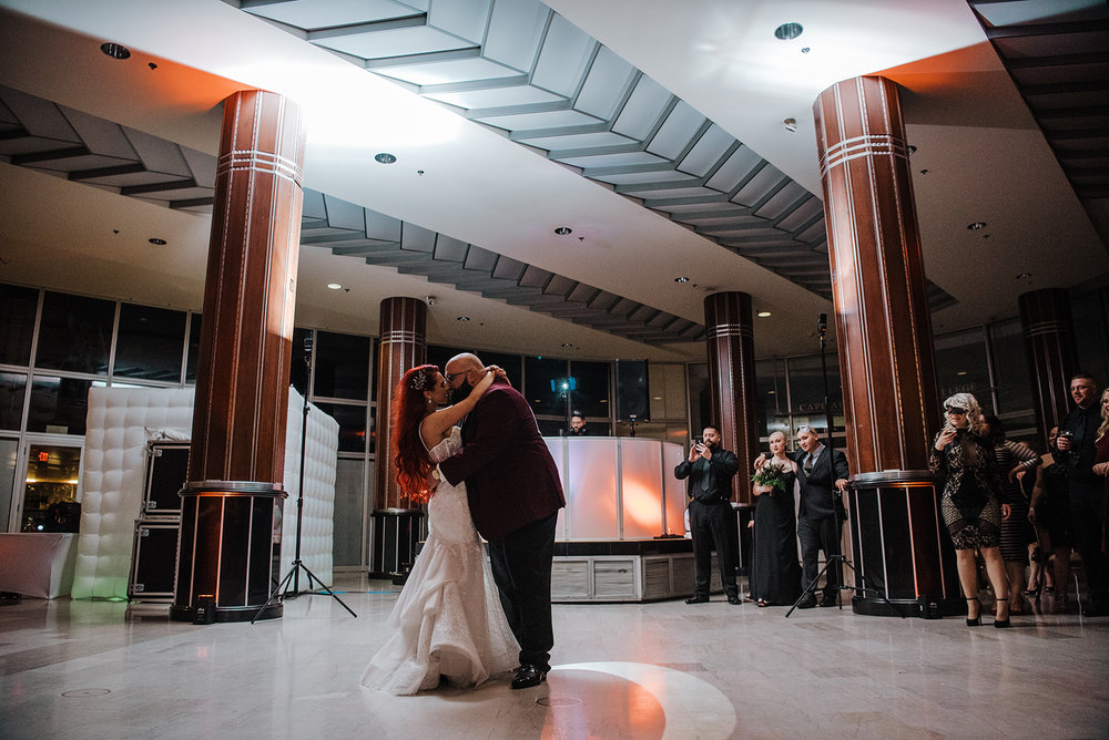 First dance with bride and groom with their name in the lighting on the ground - Pearl Weddings & Events