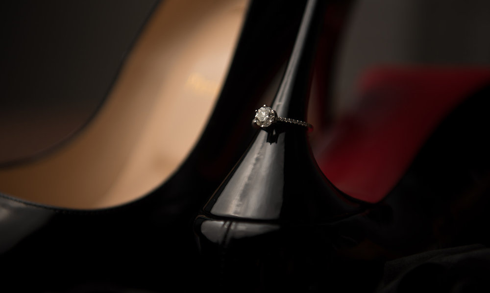 wedding ring on the heel of the LouBoutin red sole bride shoes - Pearl Weddings &Events