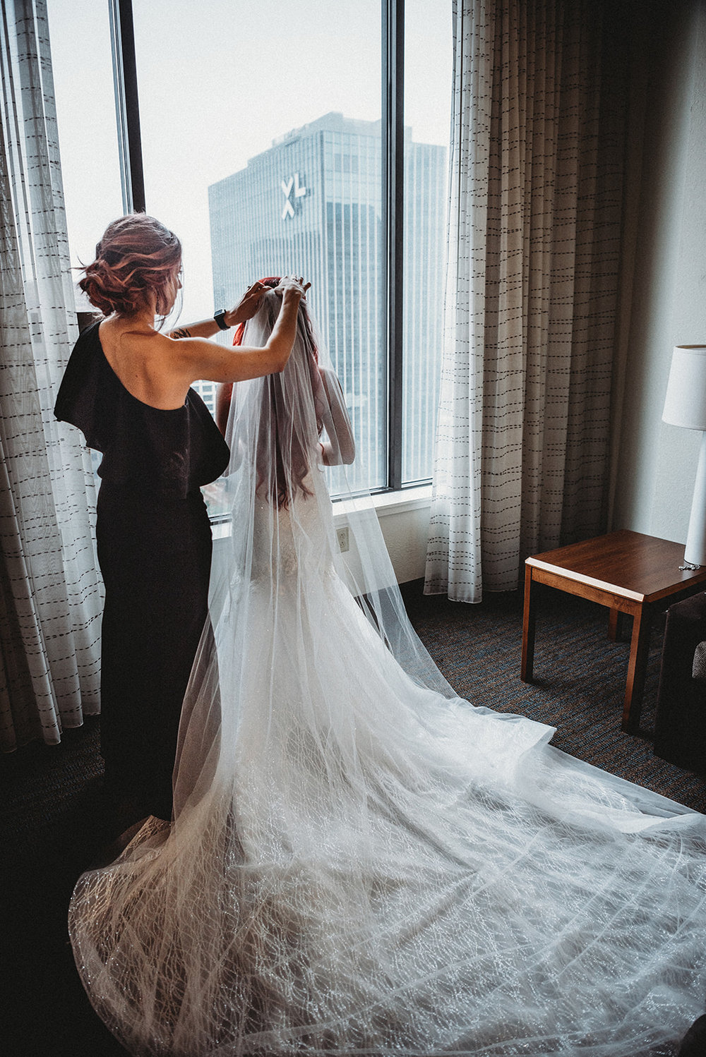 Bride with Calla Blanche dress, LouBoutin shoes and a gorgeous veil with a long train in Hartford, Connecticut - Pearl Weddings & Events