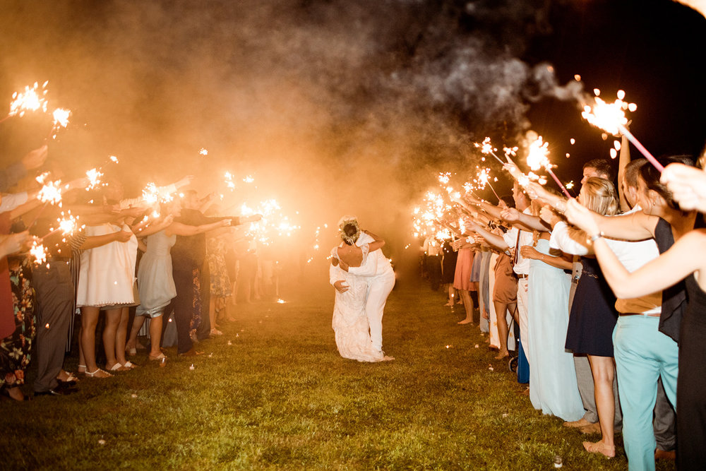 Sparkler exit at a backyard wedding in Chester Connecticut - Pearl Weddings & Events