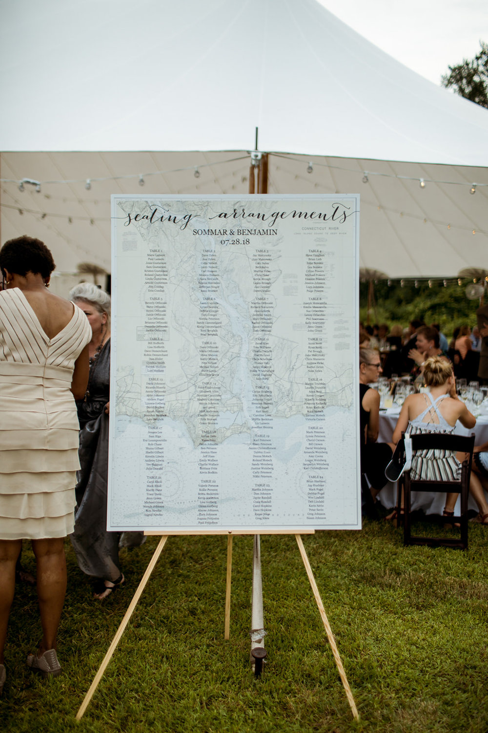 map seating chart for guests names! Outdoor tented Seaside wedding in Chester, Connecticut. - Pearl Weddings & Events